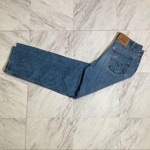 Vintage Levi's 550 light wash orange tab jeans